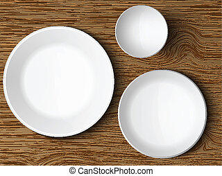 set of white dishes on a wooden