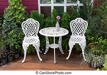 set of white furniture with table and chairs decorated