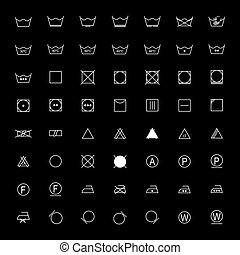 Set of white laundry symbols on black background, vector illustration
