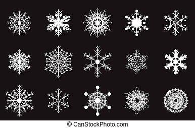 set of white snowflakes on a black background