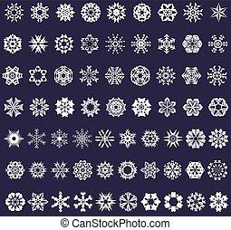 set of white snowflakes on a dark background