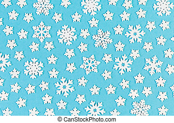 Set of white snowflakes on colorful background. Top view of Christmas ornament. New Year time concept with empty space for your design