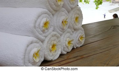 Set of white towels and Frangipani flowers. zen garden for relaxation balance and harmony spirituality or wellness.