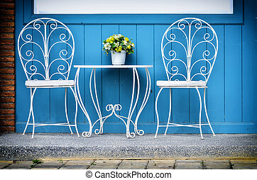 Set of white vintage chairs standing