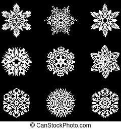 Set of winter snowflakes for Christmas. White contour on black background