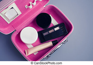 Set of woman's cosmetics in a bag. Women's secrets. Cosmetics, perfume, brushes, powder, highlighter, concealer, patelle with eye shadows. female cosmetics bag on white background. Make up. Copy space