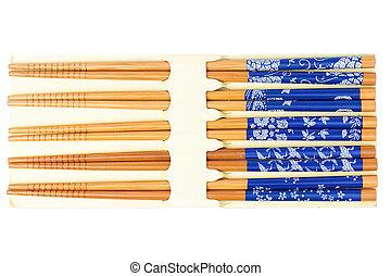 Set of wood chopsticks on white