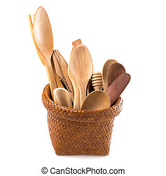 Set of wooden cutlery in Wicker baskets isolated on a white background