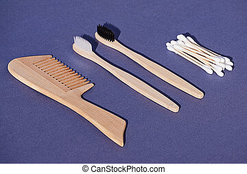 Set of wooden hairbrush, toothbrush and cotton buds from bamboo