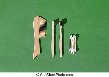 Set of wooden hairbrush, toothbrush and cotton buds made from bamboo