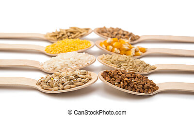 set of wooden spoons with cereals isolated