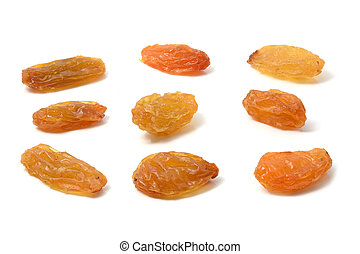Set of yellow raisins on white