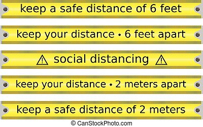 set of yellow tape caution concerning social or safe ...