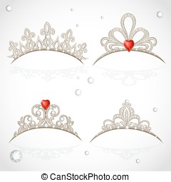 Set openwork jewelry tiaras with diamonds and faceted red stones in a heart shape on white background