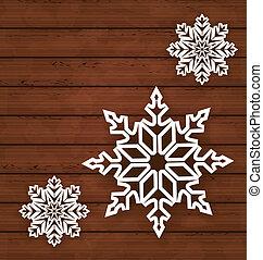 Set snowflakes on wooden background