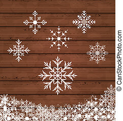 Set snowflakes on wooden texture
