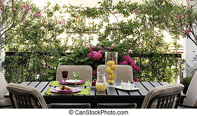 table in the terrace - set table in the terrace