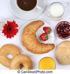 Set table with breakfast and coffee, orange juice from above