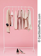 Sets of clothes on a hanger