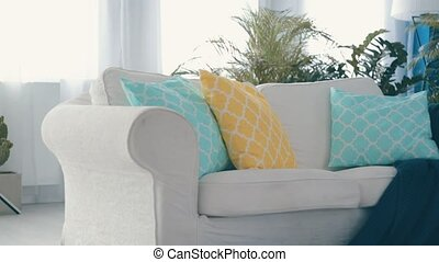 Settee in the apartment - White settee with pillows in the...