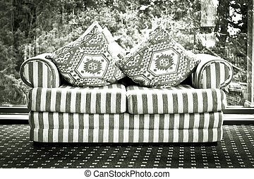 Settee - A double sofa in black and white