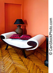 Settee - White settee in orange living room interior