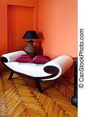 Settee - White settee in orange living room interior