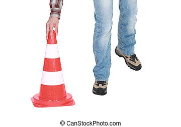 Setting down a traffic pylon