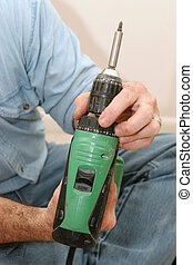 Setting Drill Torque - A workman setting the proper torque...