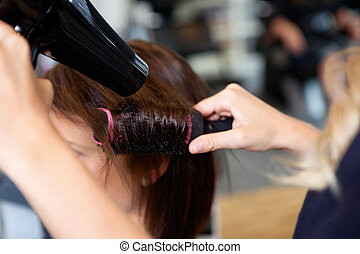 Setting Hair Properly - Close up of beautician's hand...