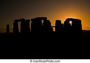 Stonehenge - Setting orange sun behind the massive stones...