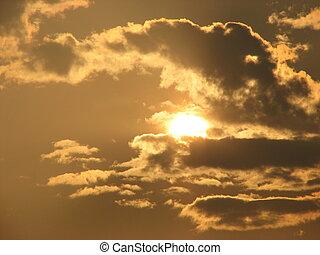 Setting Sun - Beautiful clouds blocking a bit of the setting...