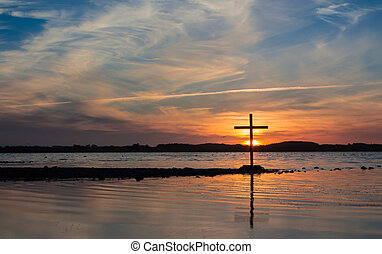 Setting Sun Cross - Lake at sunset of wonderful color, with...