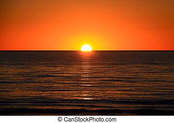 Setting Sun over Larg\'s Bay Beach, Adelaide, Australia