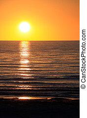 Setting Sun over Ocean. Largs Bay, Adelaide, Australia