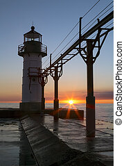 Setting Sun Silhouettes Lighthouse at St. Joseph - The...