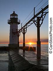 Setting Sun Silhouettes Lighthouse at St. Joseph