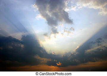 Setting sun - Some amazing beams of light/shadow coming from...
