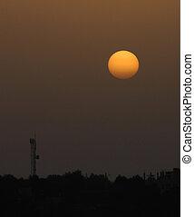 Setting sun - The setting sun next to a communications post