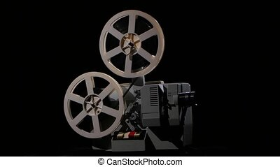 Setting up the projector during its operation. Studio black background