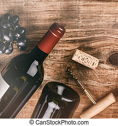 Setting with bottle of red wine, grape and corks. Wine list concept