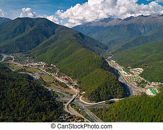 Settlement in Mountains - Aerial view of Krasnaya Poluana ...