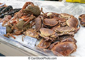 Setubal, Portugal - 18 December, 2020: fresh crabs for sale in the Livramento Market in Setubal