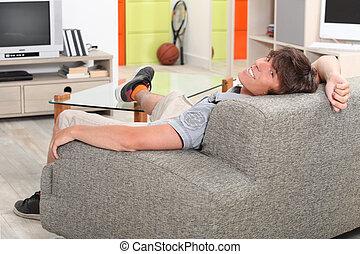 seu, relaxante, sofá, jovem, pé, tabela, homem