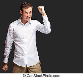 seu, zangado, jovem, agarrando punho, retrato, homem