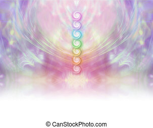 Symmetrical pastel colored wispy misty background with vertical row of seven chakras place in center