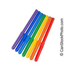 Seven felt pens lie in a row