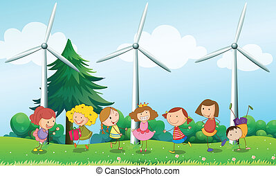 Seven kids playing in the hill with three windmills