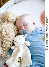 Seven month old baby sound asleep in crib