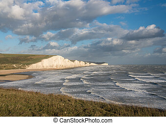 Strong waves by the chalk cliffs of the Seven Sisters at Cuckmere Haven